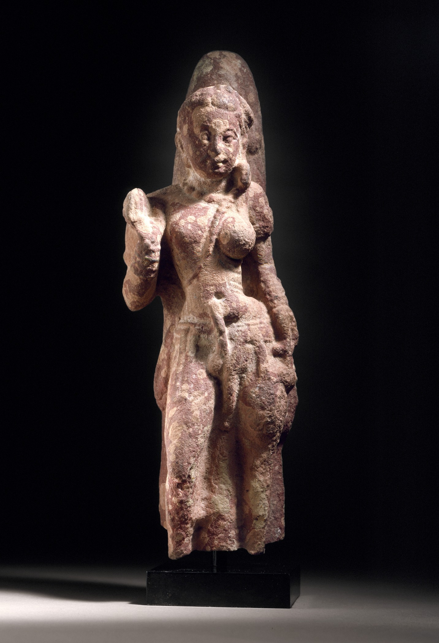 The Androgynous Form of Shiva and Parvati (Ardhanarishvara). India, Uttar Pradesh, Mathura, 2nd-3rd century sculpture. Mottled red sandstone. Los Angeles County Museum of Art.
